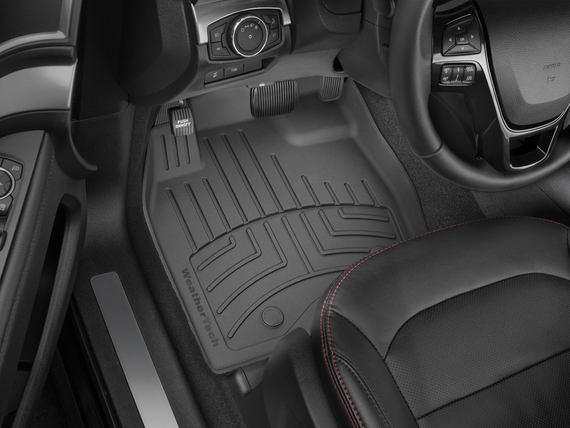 Black WeatherTech FloorLiner HP covering the driver's side footwell of a vehicle.