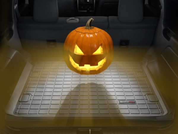 The WeatherTech CargoLiner with a Jack-o-lantern hovering over it.