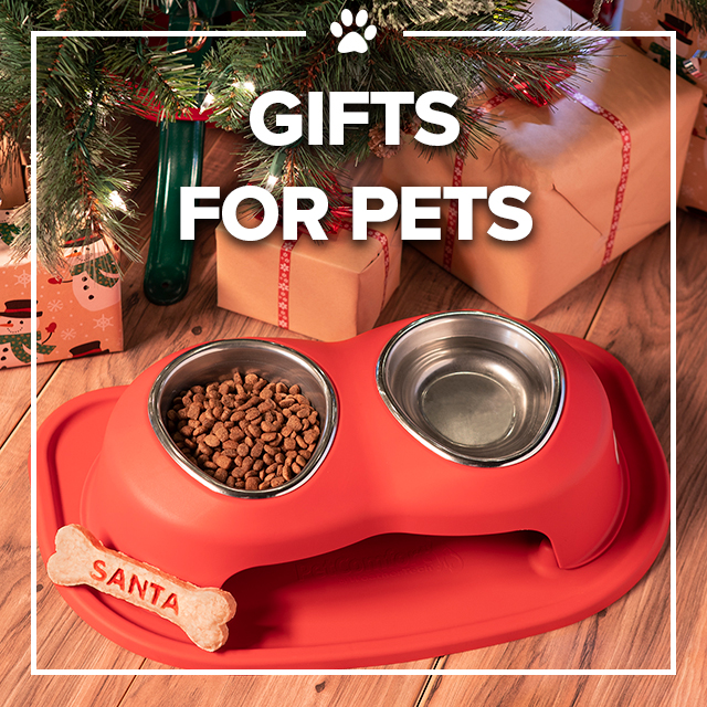 Image of text that says Gifts for Pets with a pet feeding system below a christmas tree.