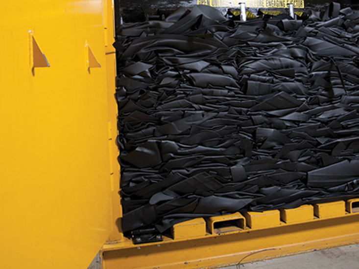 Variety of WeatherTech Floor Mats being prepared for recycling.