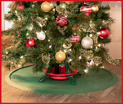 Photograph of the Christmas Tree Mat placed under a decorated Christmas Tree.