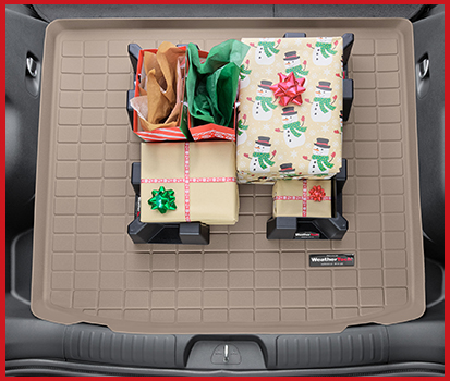 Photograph of gifts in the trunk of a vehicle being held in place by CargoTech pieces to prevent them from sliding around.