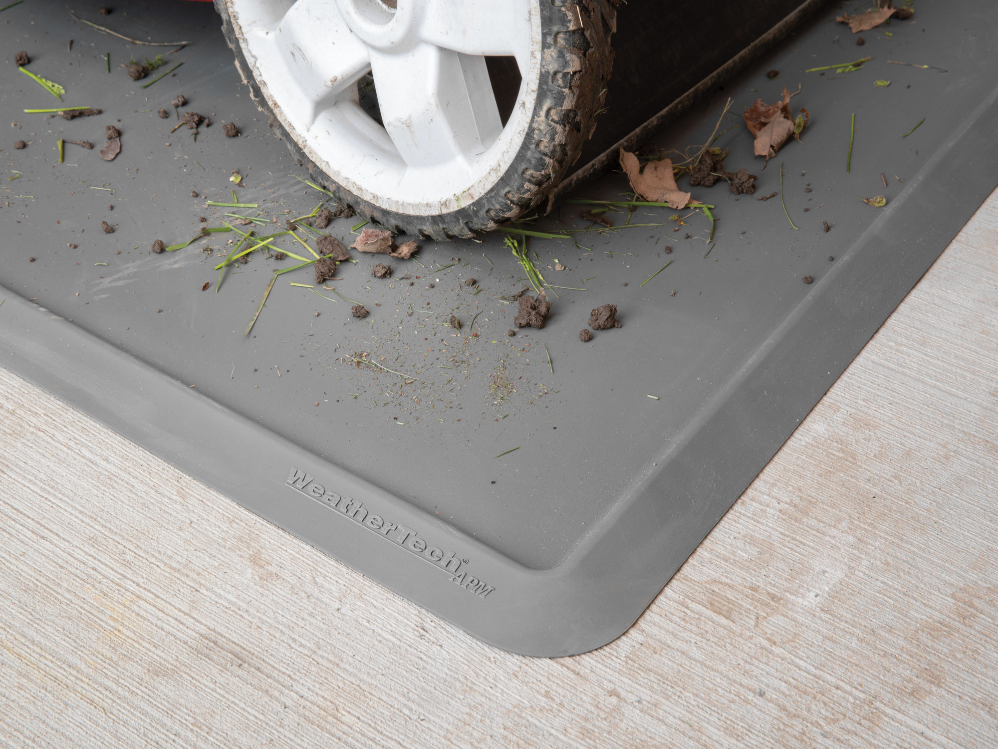 Close up of a lawnmover on an all purpose mat.
