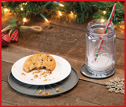 Photograph of milk and cookies on a coaster displayed for Santa