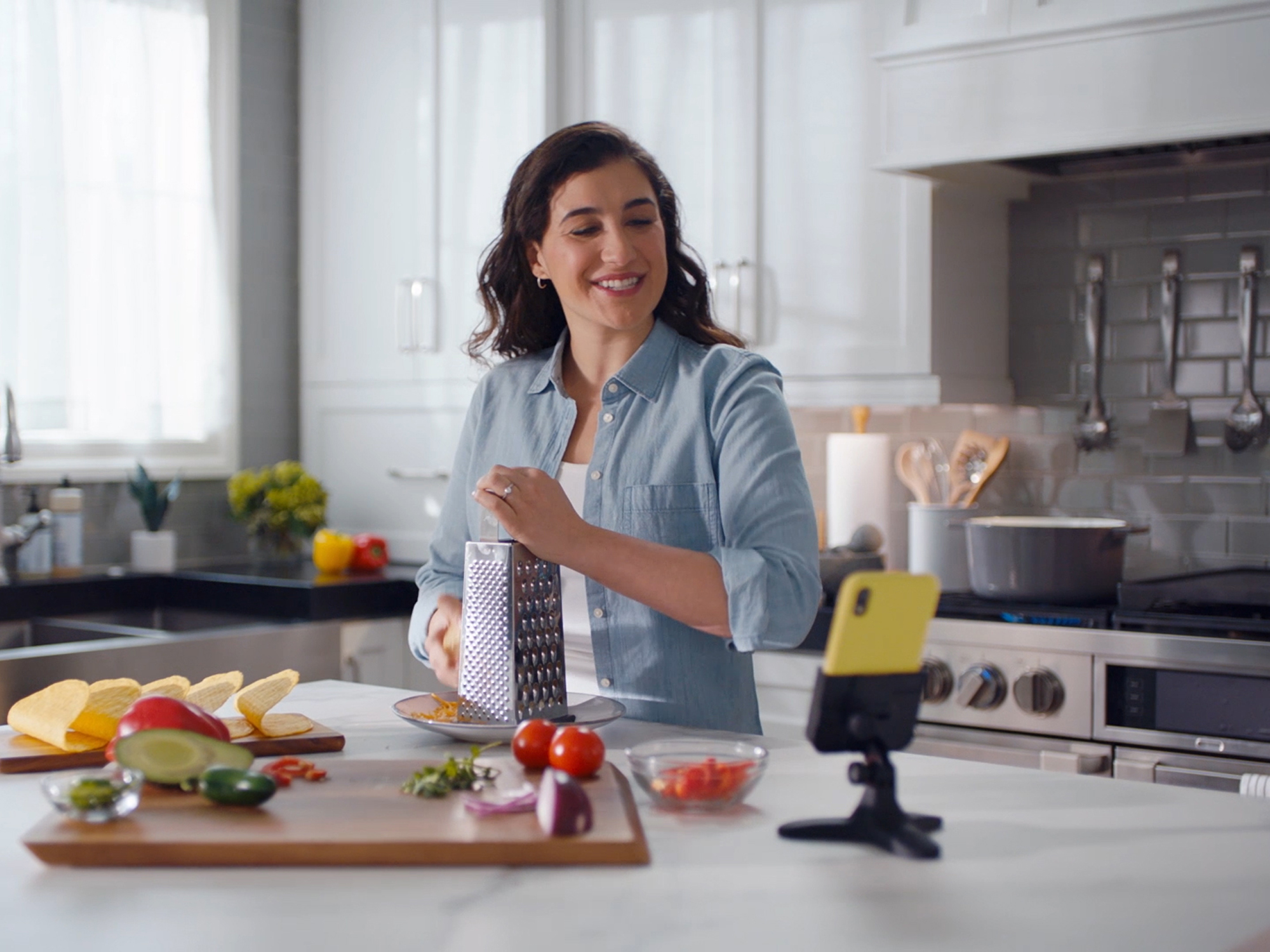 Woman_ with_DeskFone_Video_Chat_in_Kitchen
