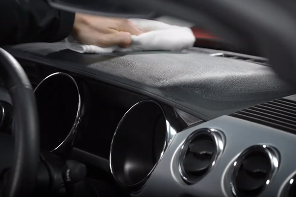 Wiping down the car's dashboard