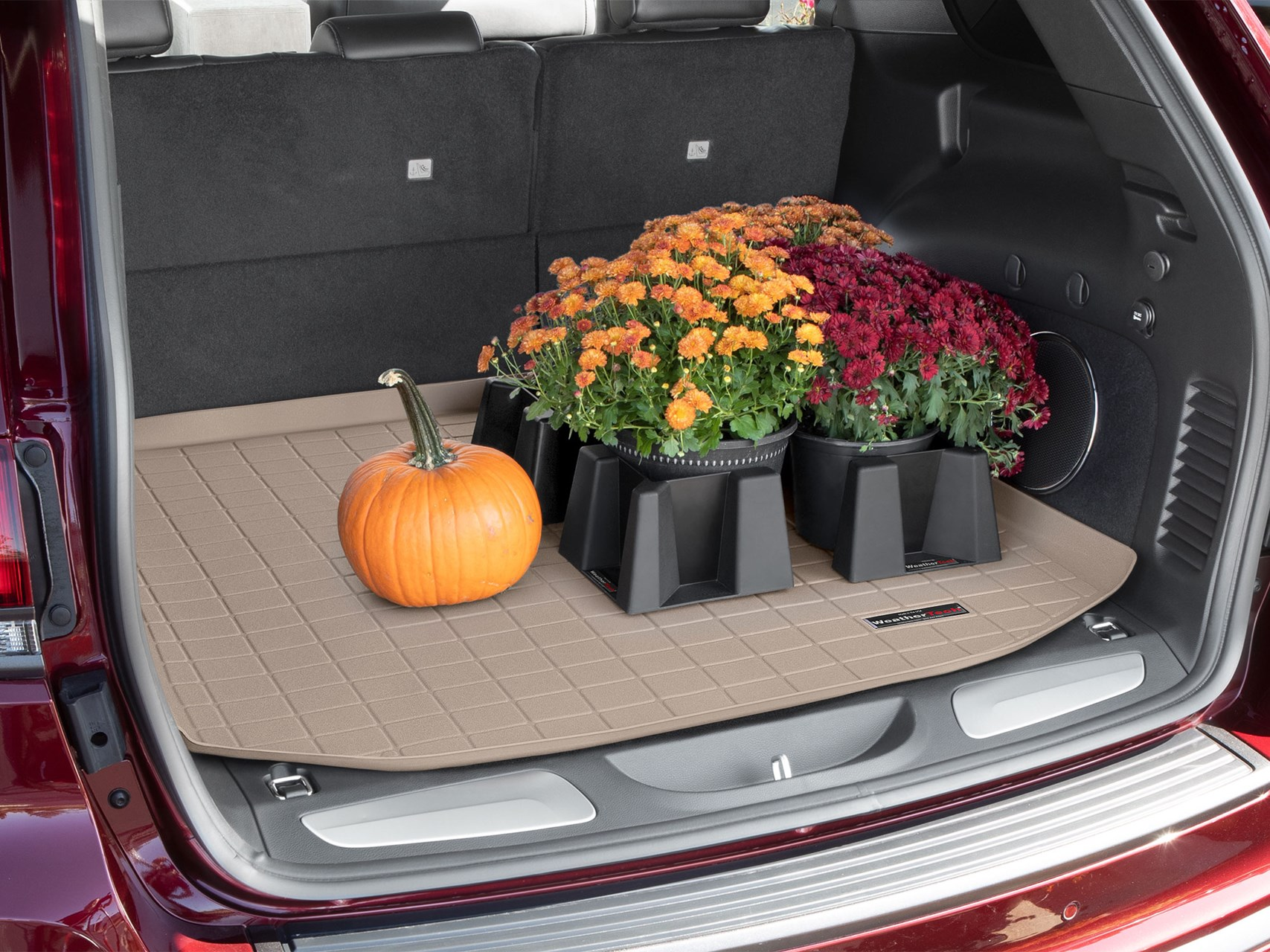 Tan WeatherTech Cargo Liner with pPumpkins, mums and gourds all organized with CargoTech. Cargo Liner protects your car's cargo or trunk area from spills, dirt and other messes.