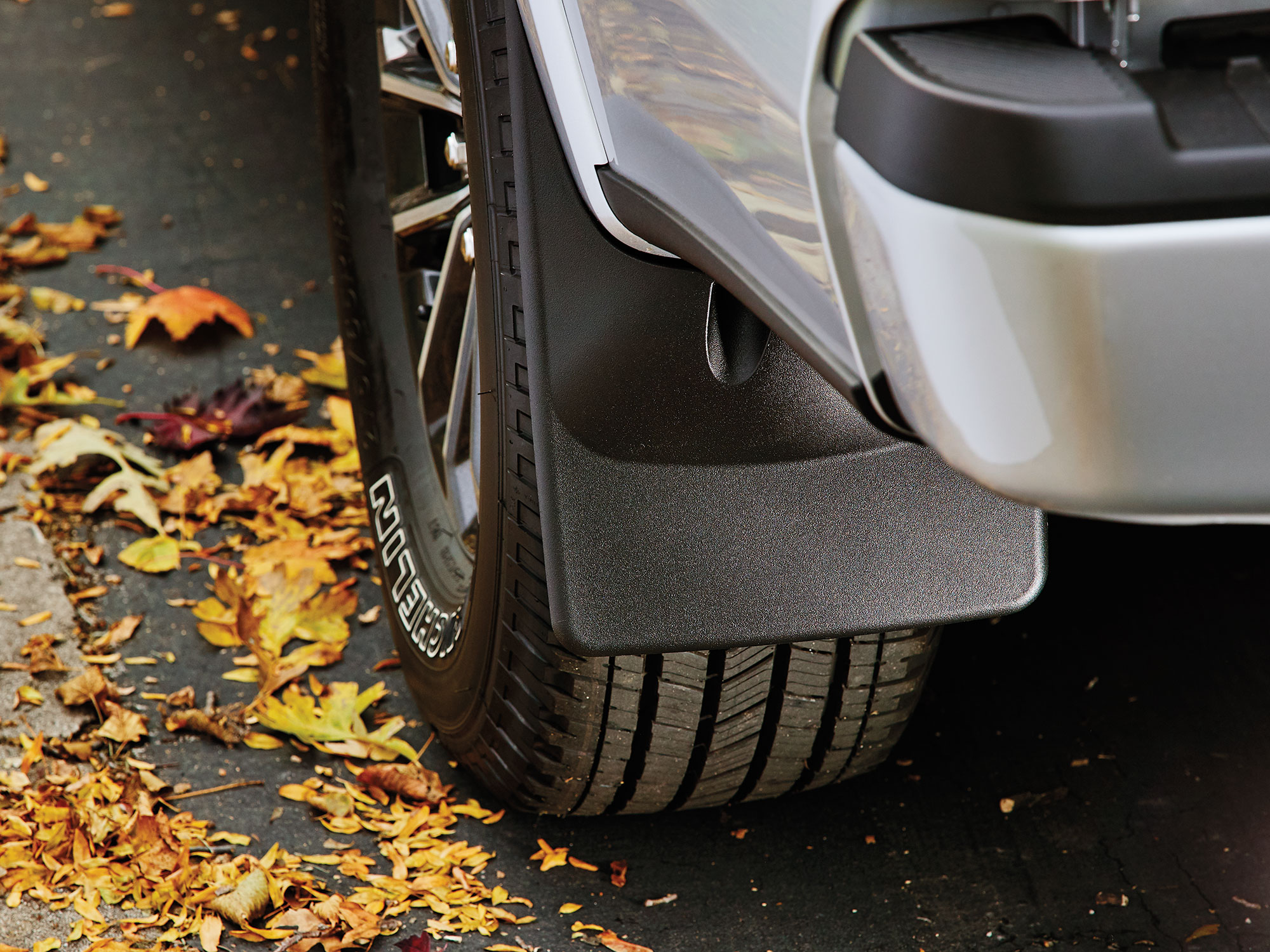 WeatherTech MudFlaps, mounted onto a silver SUV, help protect your fenders from rocks, mud, dirt and more!