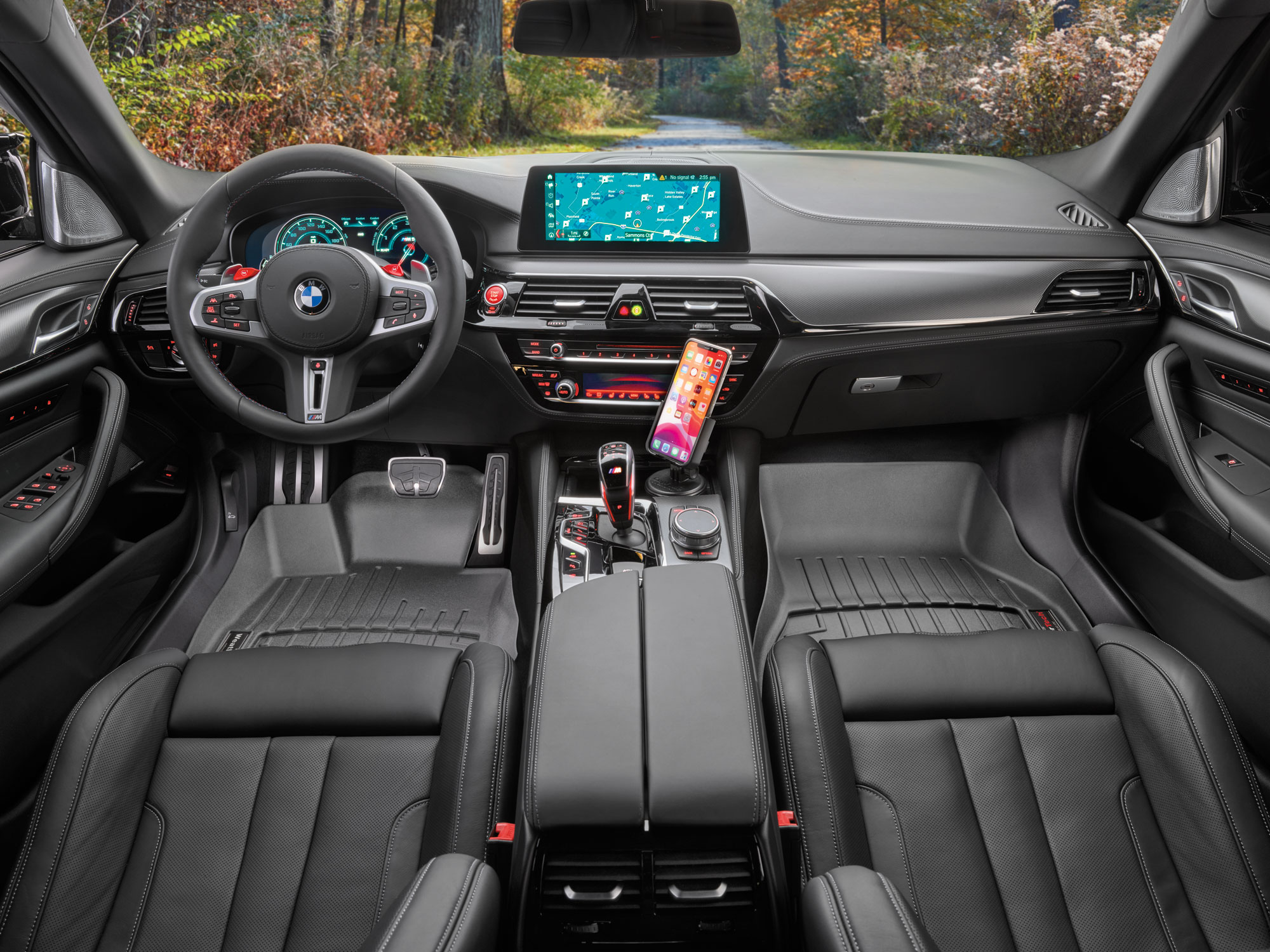 Black WeatherTech FloorLiners and CupFone in a black BMW. WeatherTech FloorLiners will keep the interior of your vehicle protected from autumn weather.