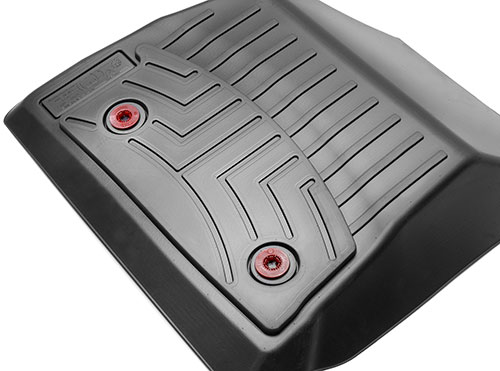 Bottom side view of button clip fasteners on WeatherTech floor mats