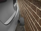 SUV with BumpStep against a brick wall. BY WEATHERTECH
