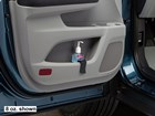 Door pocket hand sanitizer holder installed in car BY WEATHERTECH