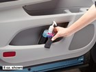 Woman using hand sanitizer from pocket holder. BY WEATHERTECH