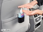 Backseat passenger pumping hand sanitizer. BY WEATHERTECH
