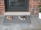 Shoes sitting on OutdoorMat BY WEATHERTECH