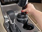 Woman installing CupFone with StickySleeve. BY WEATHERTECH