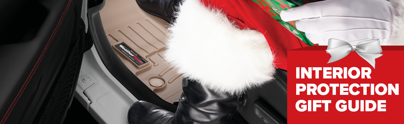 Photograph of Santa's boots driving a vehicle with FloorLiners installed featuring text that says Interior Protection Gift Guide
