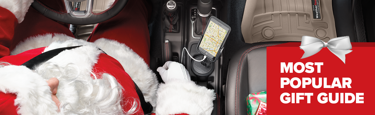 Photograph of a Santa driving a vehicle a CupFone in the cup holder and gifts on the front seat featuring text that says Most Popular Gift Guide