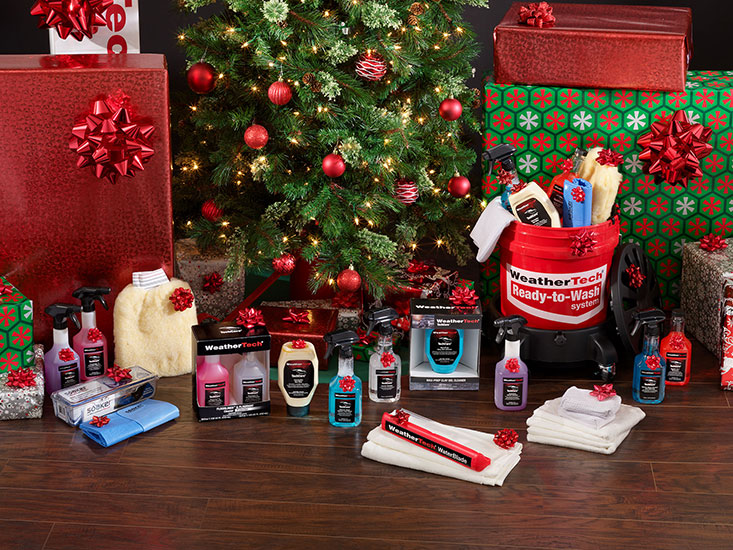 WeatherTech TechCare products with other gifts under a Christmas tree.
