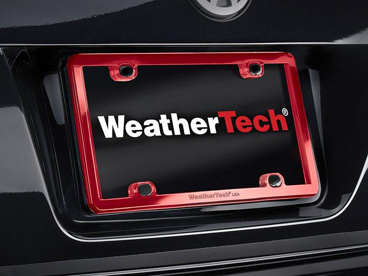 Red License Plate Frame on a black sedan car.