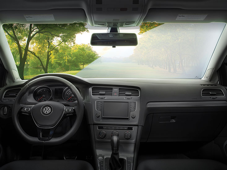 Side-by-side comparison of a clean inside windshield and a dirty inside windshield.