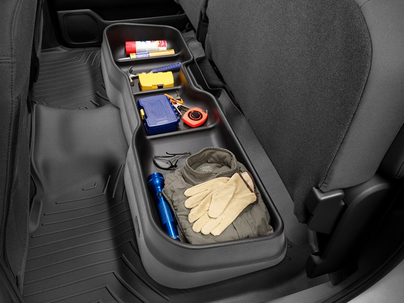 WeatherTech UnderSeat Storage System with tools stored inside.