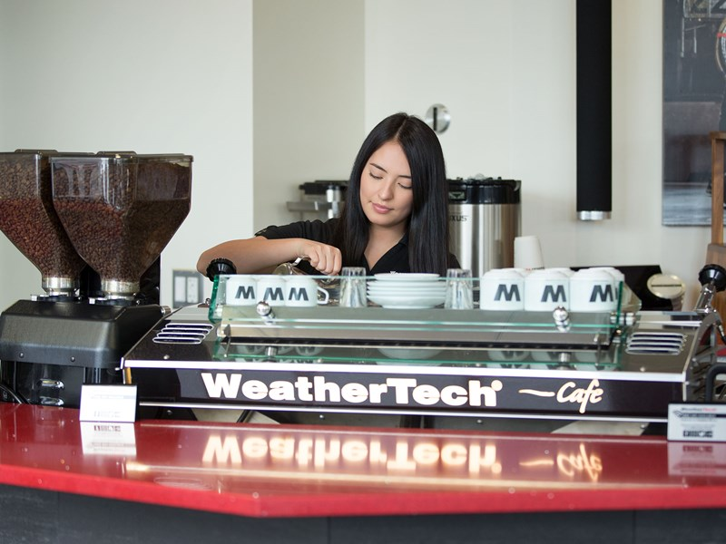 Barista preparing Coffee at the WeatherTech Factory Store.