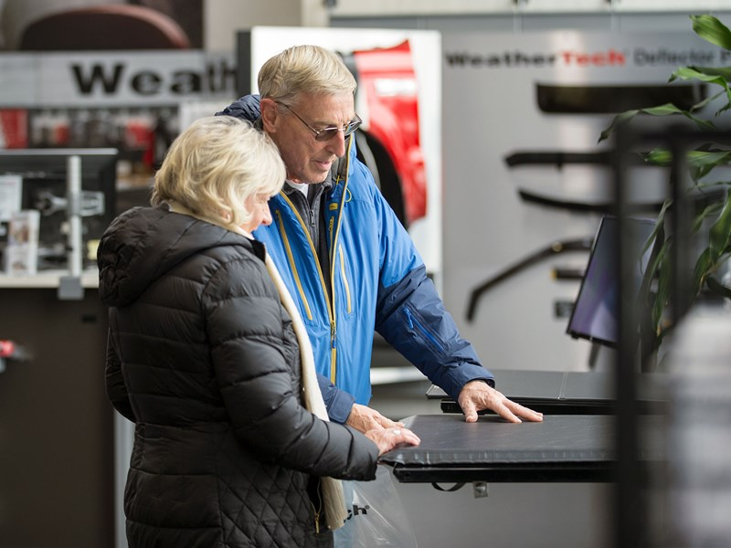 Couple viewing products at the WeatherTech Factory Store.