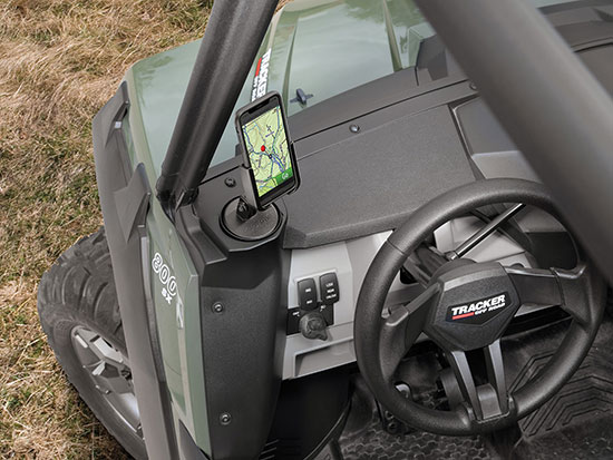 WeatherTech CupFone in the front cup holder of a UTV.