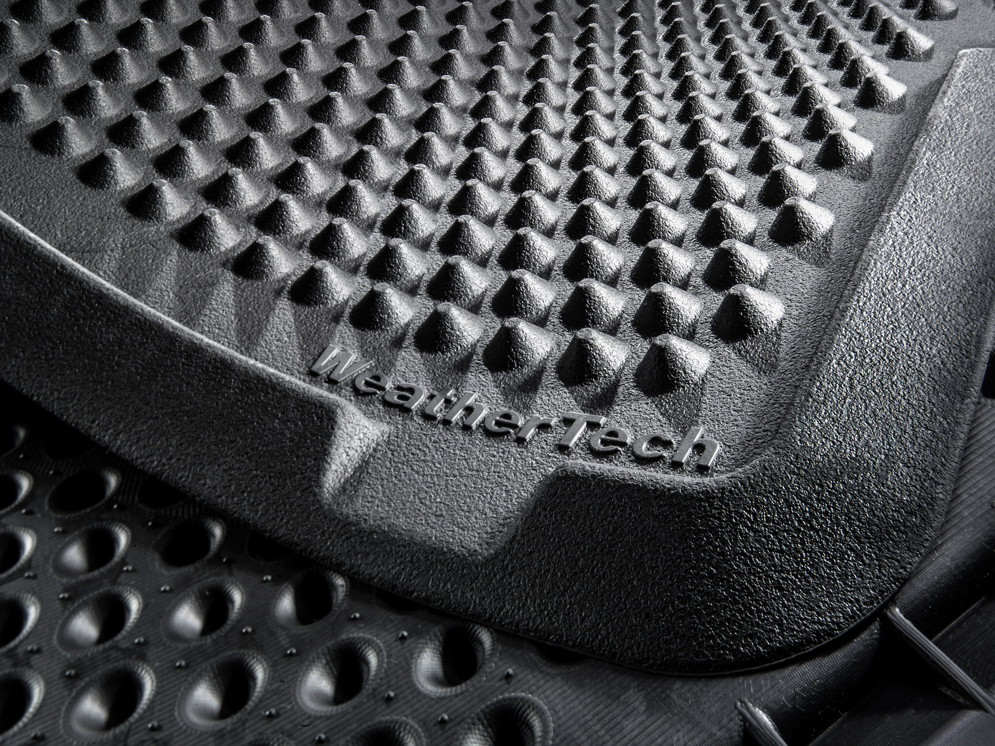 WeatherTech Outdoor Mat's semi-rigid cones help keep messes contained on the mat instead of tracked all over your house. Perfect for use with cat litter or in a workshop.