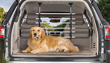 WeatherTech Pet Barrier installed in the cargo area of an SUV. Pet Barrier keeps pets safe and drivers distraction free.