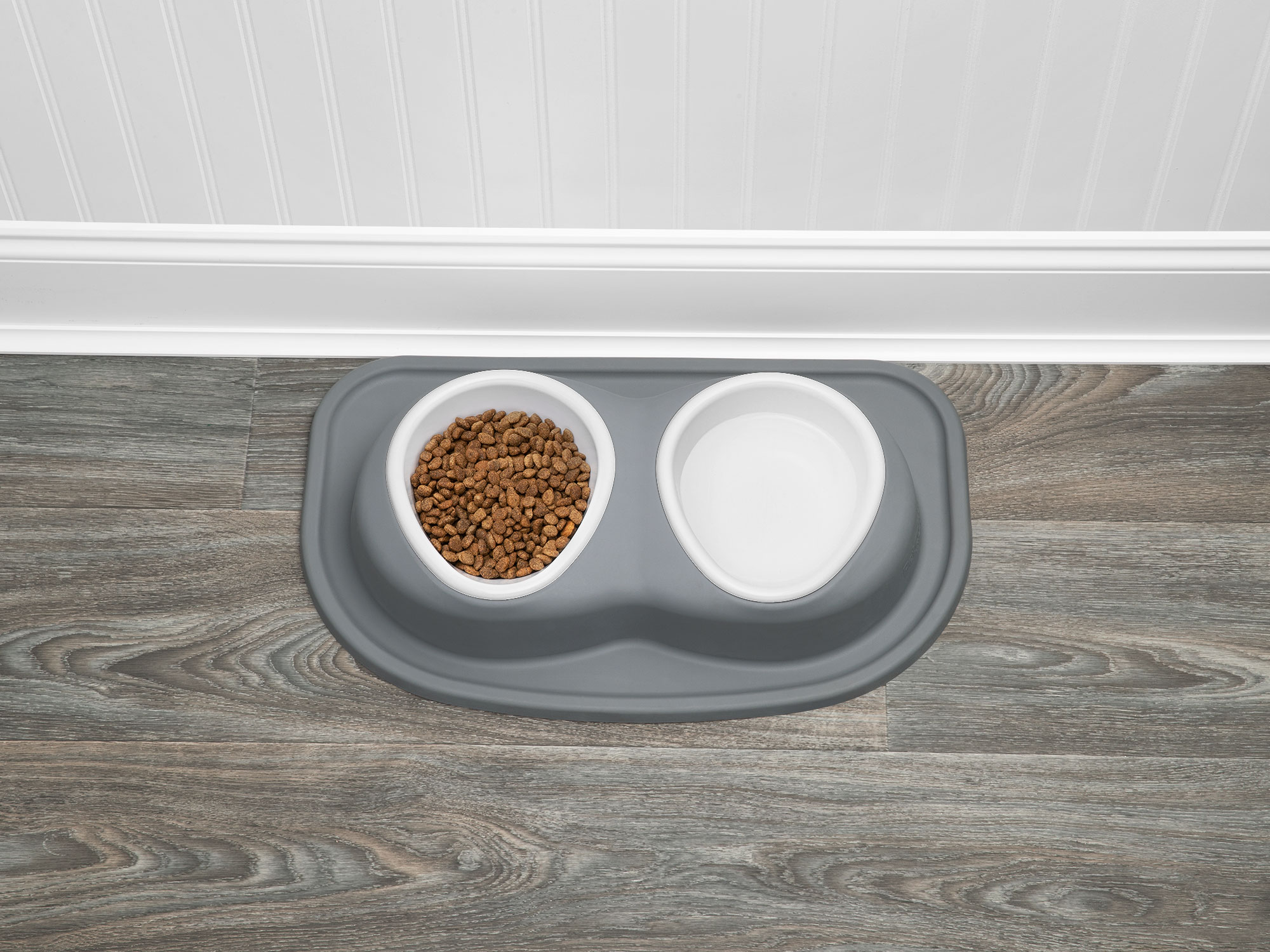 Grey Double Low Pet Feeding System with plastic bowls, filled with food and water for a dog.