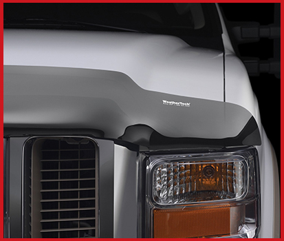 Image shown of the grill of a vehicle with a Stone and Bug Deflector attached to the hood.