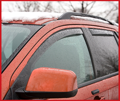 Image shown of a vehicle in winter featuring Side Window Deflectors in the window.