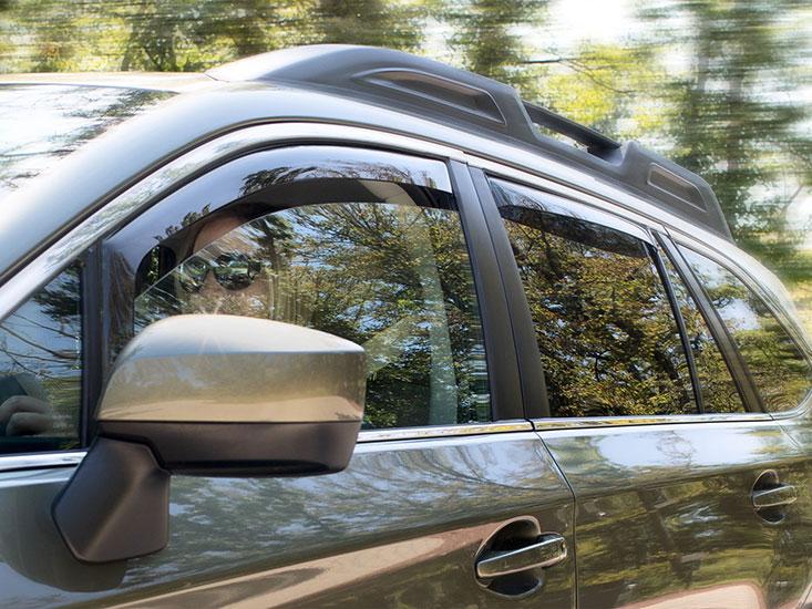 WeatherTech Side Window Deflectors installed on a Subaru Outback.