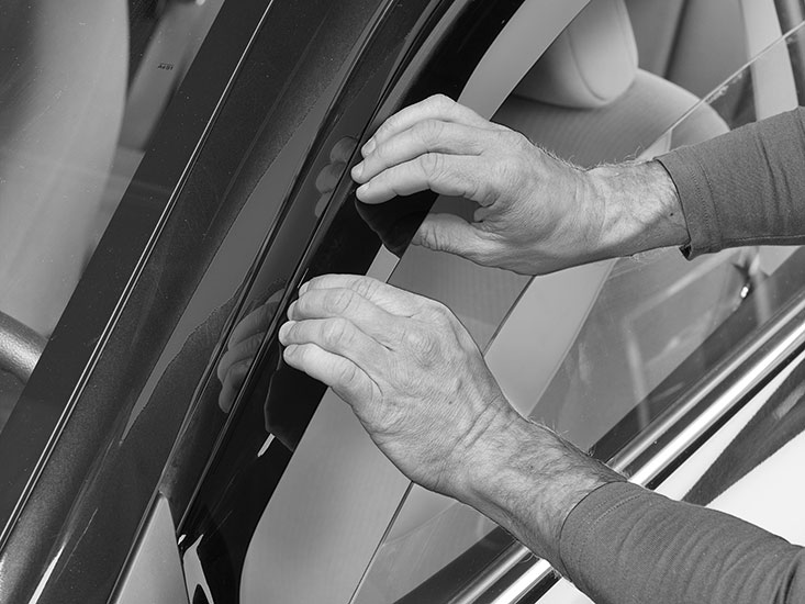 Once the front and rear edges have been installed, you will need to tuck in the rest of the deflector, starting at the front.