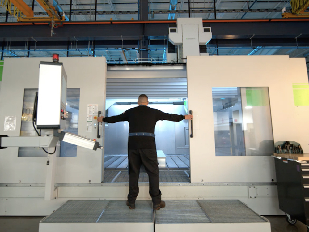 WeatherTech employee closing the doors to a factory machine.