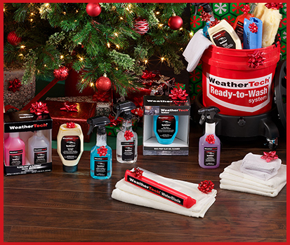 Photograph of TechCare® Auto Detailing Products displayed in front of a Christmas tree as gifts.