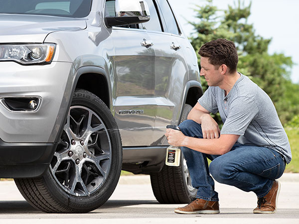 man cleaning tires with TechCare