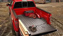 WeatherTech TechLiner in a red pickup truck with tools and building materials.