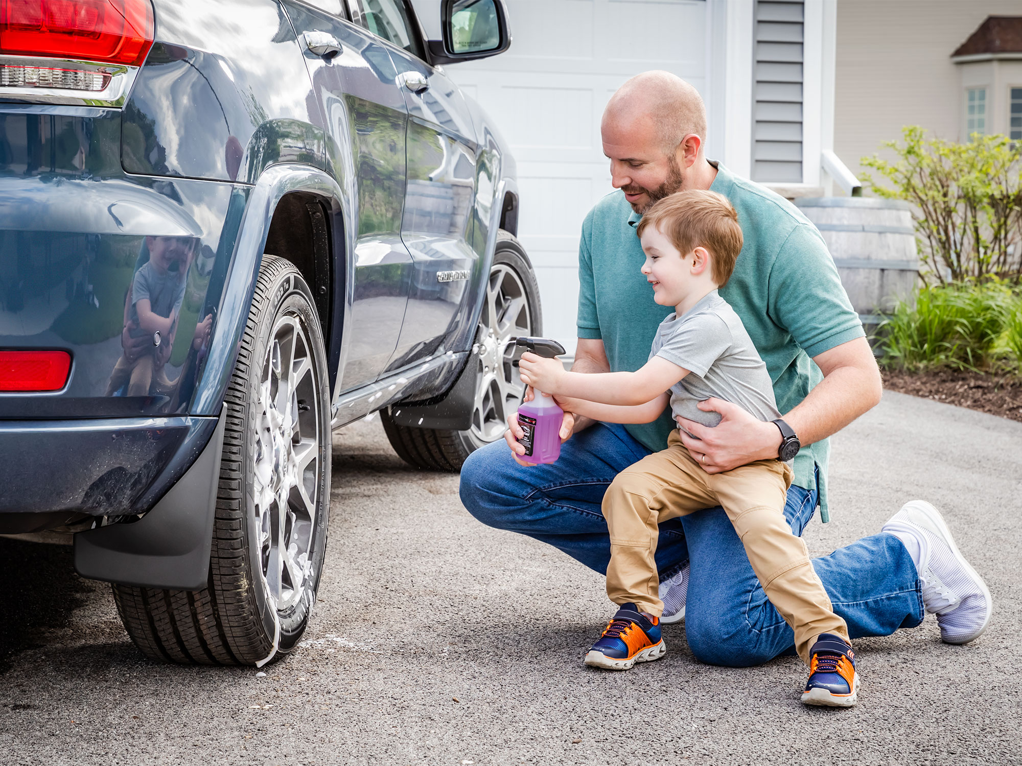 Father and son washing dad's car together.
