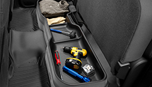 Under Seat Storage System with tools and other work supplies.