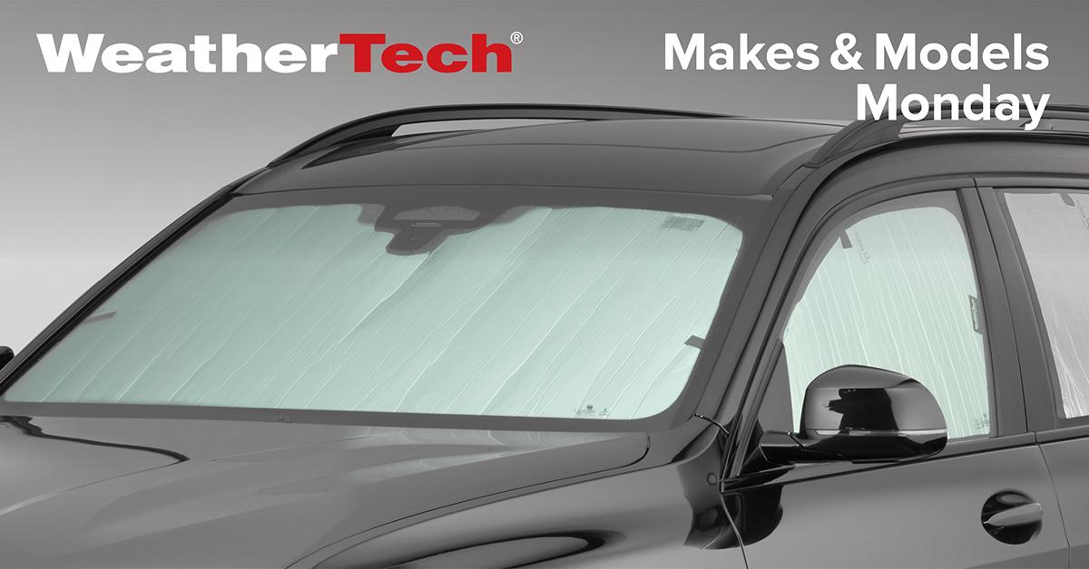 WeatherTech SunShade installed on a black SUV.