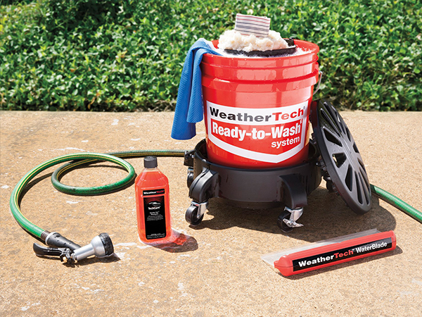 WeatherTech Ready to wash system on a driveway.