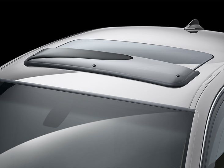 WeatherTech Sunroof Deflector installed on a silver sedan.