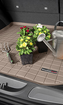 Cargo Liner with flowers and gardening tools on it.
