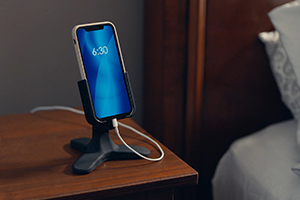 DeskFone sitting on a nightstand in a bedroom