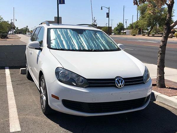 sun shade covers car in desert heat