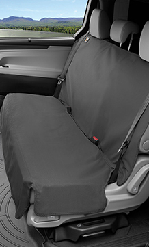 Seat protector covering a bench style seat inside a vehicle.