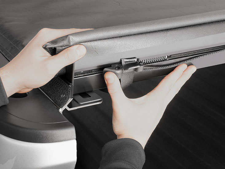 Inspecting your cover's latches, bolts, clamps and mounted hardware is an important first step.